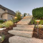 Natural stone steps with Kichler LED landscape lighting.